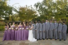 """David's Bridal bridemaid dresses in Wisteria, which appears to be the closest color they have to lilac. Also notice the """"gun metal gray"""" tuxes with lavender ties. See Nate- guys can wear purple and still look macho! ;-)"""