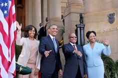The Obamas in Africa | An official South African government-issued photo of South African President Jacob Zuma and his wife Tobeka Zuma standing alongside US President Barack Obama and his wife Michelle Obama as they wave to onlookers outside the Union Buildings in Pretoria. | Photo: Elmond Jiyane/ EPA