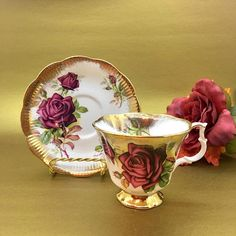 Stunning Royal Albert tea cup set made in the 1960s-1970s. This Gainesborough shaped cup is decorated with large red roses and brushed gold all along the trim. A lovely addition to any Royal Albert collection! No chips, cracks, or crazing. The saucer measures 4 3/4 The tea cup measures