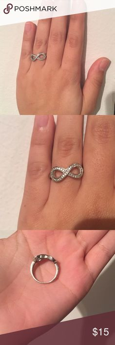 Stainless steel (925) infiniti rhinestone ring Stainless steel (925) rhinestone infinity sign ring. Size is comparable to a 7-7 1/2 Pandora ring. Super cute for more fancy wear, or everyday. In perfect condition. Jewelry Rings