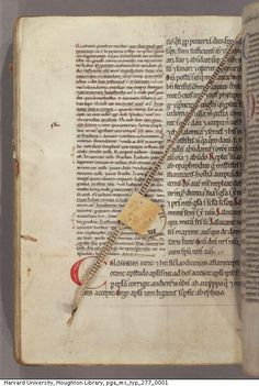Clever medieval bookmark in original book: pull down and rotating disk to mark line and column (@HoughtonLibTyp277). pic.twitter.com/ljHEc2Q5Hj
