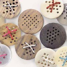 Love the buttons with multiple holes, could sew them on in so many ways - try making with wood pieces (drill holes) or maybe polymer clay (buttons by hella jongerius)