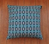 Striking 'Paperchain' lambswool cushion - this cheerful yet contemporary design has a strong graphic appeal and will keep you extra cosy! by Heather Shields