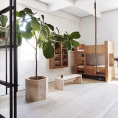 We're inspired by this incredible children's bedroom found in the Tribeca home of Soren Rose, a NYC-based product designer and interior architect. Awash with natural light, bare wood and hints of greenery, it embraces minimalism over stimulation, providing an environment for creative play.    Image from our friends @aprilandmay