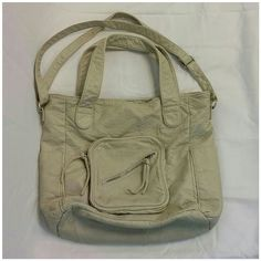 "Aeropostale Taupe Large Shoulder Bag Aeropostale Taupe Large Shoulder Bag , very soft vegan leather outside, cream cloth inside, 7"" x 6 1/2"" x 3/4"" front zipper pouch with slanted zipper pocket on top of it, 7"" x 5"" pouch on each end, inside zipper pocket, 47"" maximum length adjustable shoulder strap, 13"" x 13"" x 5"" overall size, not structured, soft and floppy, numbers on tag (see picture) rn#121726  ca53201 Sold Out OnLine! Inside cloth is balling/piling (see pictures) Outside is…"