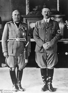 Benito Mussolini (1883-1945) on the left. Mussolini was a socialist before becoming a fascist. Responsible for 300,000 deaths in Ethiopia, Libya, Yugoslavia, and WWII. Hitler on the right.