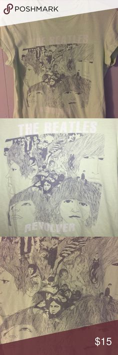 """The Beatles Tee Mint green Beatles """"Revolver"""" tee shirt. White lettering and black stenciled image. Pictures shown with and without flash to show detail/color. Tagged a size large but more of a fitted medium. 100% cotton. Great condition! 💰Bundle discount: 2-20% 3-25% 4+-30%. Let me know before purchasing more/less than 3 items and I will adjust my settings for you. The Beatles Tops Tees - Short Sleeve"""