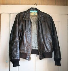 This is a rare, authentic 1940s mens motorcycle jacket made of brown tanned horsehide. It is the best leather - perfectly rugged, still supple, strong