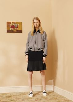 Mother of Pearl   Pre-Fall 2016   24 Monochrome checkered bomber jacket and black mini skirt with pleated hem