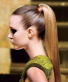 Polished Ponytail: Apply blow-dry gel to towel-dried hair and blow hair dry straight with a round brush. Flat iron your hair, until it's nice and sleek. Smooth your hair into a high ponytail, leaving one small section free. Secure it with an elastic. Take the remaining small section of hair, and wrap it around the elastic of the pony. Secure with a bobby pin. Apply a dab of styling gel to your palms and slick them over your hairline to tame flyaways