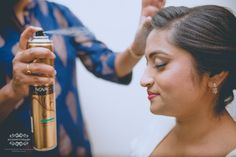 """The is once in a life time shot for us, usually we take multiple shot for a picture perfect """"hair spray"""" shot and we go on taking multiple shots of this particular picture, luck for us, this time there were no retakes! Making it a truly candid shot of the bride getting ready!   Makeover by: Angels Blush-Lavanya Eugine Bridal MakeupArtist  #bride #makeup #bridalmakup #gettingready #churchwedding #bridemakeup"""