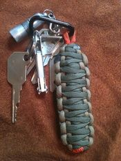 I LOVE these things!!  Great gifts for the boys... survivalstraps.com