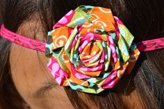 sassy rosette attached to hot pink leopard headband for children and adults.. www.sosewbowtiful.etsy.com