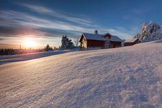Snowbound Hamlet at Sunset - Log cabins near Sjusjoen in the Lillehammer area at Sunset