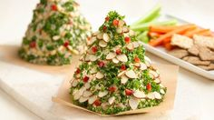 Holiday Christmas Tree-Shaped Cheese Ball.  This looks like it's sitting on top of a tortilla shell.  So cute!