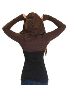 This hooded shrug adds instant arms to any sleeveless top you have! It's a great layering piece to wear over tank tops or under sleeveless vests. It has awesome thumbholes and a cute and generous hood