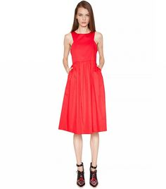 Red Dresses to Wear Through Holiday Season and Beyond via @WhoWhatWear  Pixie MarketRed Midi Dress($99)