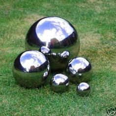 Make some mirrored lawn ornaments by spraying different sized orbs with looking glass spray paint. (Makes your backyard look larger) | Backyard hack