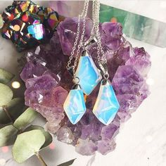 These opalite necklaces are sure glowing on this Amethyst cluster  (($26.99))