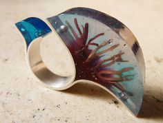 Ring | Vania Ruiz. Found sea weed, coloured resin and silver.