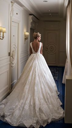 Elegant white ballgown wedding dress with v-shaped open back design; Featured Dress: Alessandra Rinaudo