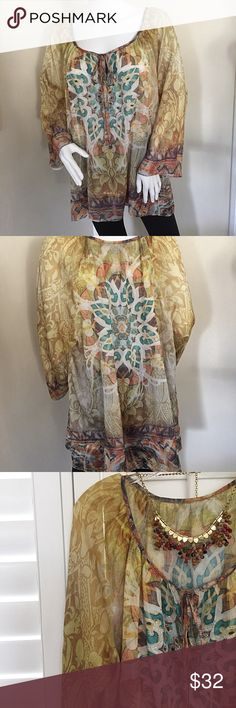 "Plus Size 18-20 Boho Gypsy Tunic with 3/4 Sleeves Absolutely gorgeous plus size tunic, sheer flowy fabric with amazing colors! Size W18-20, approximate measurements: front armpit to armpit: 25"" length front: 28"" 3/4 dolman sleeves measure about 21"" - this is a very generous cut - almost unconstructed. Slips over head, no buttons or zippers. Details too many to list! Has tiny rhinestones decorating the front medallion - stunning! Tops Tunics"
