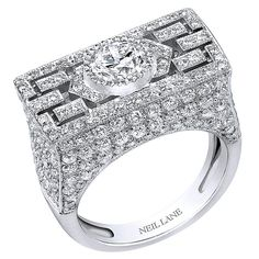 Pavé diamond ring in a horizontal platinum setting by Neil Lane