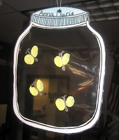 The kids were given a paper jar to cut out...tricky cutting out the inside! :) The jars were laminated and the film was left in the middle. We then fingerprinted the wings of fireflies with glow in the dark neon paint. Add a silver sharpie body and voila!! So cute!!