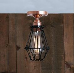Featuring a bold, contemporary design, the Juba Flush Cage Light offers a contemporary and industrial touch to residential and commercial spaces. This ceiling light fixture is encased by an attractive wire cage shade and is a great addition to any hallway, entryway, or dining room. Ideal for rooms with a low ceiling, this semi-flush ceiling light adds a modern-industrial look to any space without too much noise or visual distraction