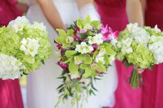 Green and white wedding flowers with fuchsia accent; hydrangea, orchids, freesia