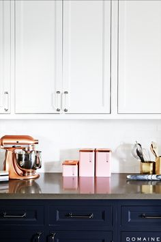 Kitchen counter with rose gold kitchen appliances and pink décor