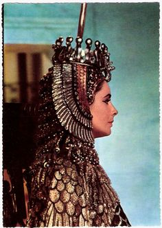 (1932-2011) | Belgian postcard by SB (Uitgeverij Best), Antwerpen (Antwerp). Photo: still for Cleopatra (Joseph L. Mankiewicz, 1963). Today Liz Taylor died. Dame Elizabeth Rosemond Taylor, DBE (1932-2011) was a British-American actress. She began as a child star, and as an adult she came to be known for her acting talent and beauty. She had a much publicised private life, including eight marriages and several near death experiences. Taylor was consi British American, Private Life, Hollywood Fashion, Golden Age Of Hollywood, Elizabeth Taylor, Costume, Cleopatra, The Girl Who, Headgear