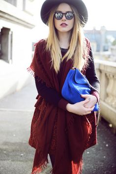 Blue bag, red scarf as a poncho, hat and sunglasses