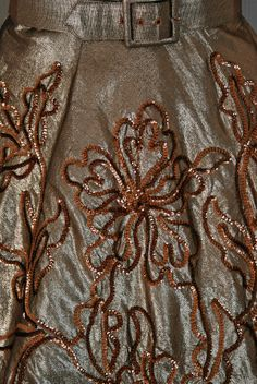 Sequin embroidery detail on a Metallic-Gold Lame party dress of the 1950s.