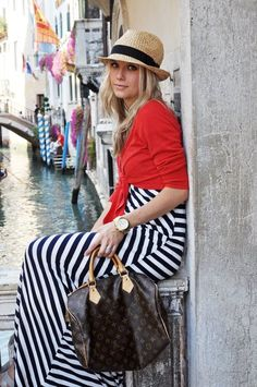 Vacation outfit. love everything about this picture, the Venice(?) backdrop, the striped maxi dress with a red cardigan...screams TOURIST CHIC!