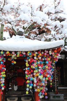 Kyoto in Winter -by Teruhide Tomori, taken on Jan 2 2015. 雛の吊るし飾り(hina-no-tsurushi-kazari) decoration around the 祠 (hokora), which is a teeny weeny shrine of Ojizō-san, the deity of children. 冬の京都。お地蔵さんの祠に飾られた雛の吊るし飾り。