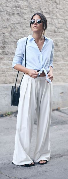 Step into spring in style with a great pair of wide leg pants and a breezy button-down blouse! Trying pairing neutral color combos like this pale blue and white for a spring fresh vibe! Don't forget a cute cross-body bag and some sunglasses!