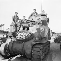 A Lee tank and crew on the bank of the Mu River near Chanta, January 1945.