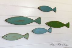 Hey, I found this really awesome Etsy listing at https://www.etsy.com/listing/181010005/school-of-wood-fish-nautical-nursery