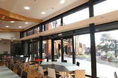 The were installed alongside aluminium windows, and which all allowed light to flood into the new dining area. Doors And Floors, Outdoor Play Areas, Aluminium Windows, Casement Windows, French Doors, Dining Area, Facade, High School, Flooring