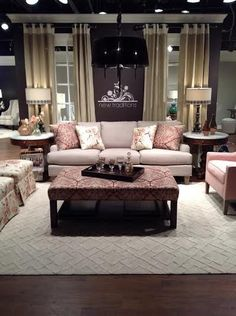 A sofa and chair set in blush color tones.  #HPMKT