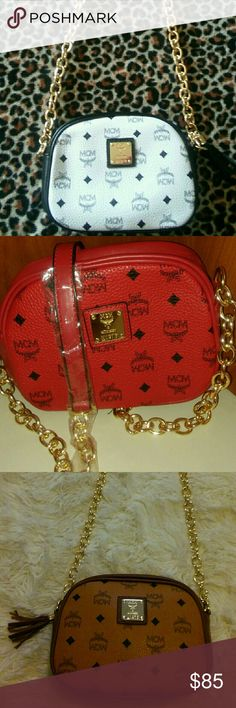 """MCM Crossbody Purses Inspired gold Chain link strap purse. 20 inch adjustable strap 9"""" 7"""" 5"""" White Red Cognac or Black. Inspired Brahmin leather strap mini crossbody handbags. 20"""" adjustable leather strap. 7"""" 6"""" 4"""" measurements for Ruby Sky Blue Black mini Crossbody bags. Same price comment color/brand. Price reflects authenticity. MCM Bags Crossbody Bags"""