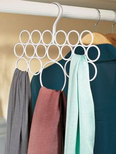 Scarf Holder - Scarves stay put and organized on the Scarf Holder. You'll love your scarf collection even more when it's neatly hung and easy to see with a glance. No clips to damage faic...just 18 hoops that hold everything from lightweight silk to bulky knit scarves. Solutions.com