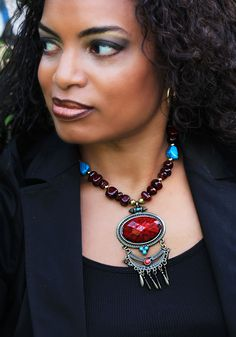 Deep burgundy gemstone beads and a fabulous burgundy stone pendant makes this necklace scream fabulous!
