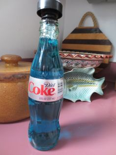 This is my sweet & wonderful tiny Mexican Coca Cola bottle--looks much nicer than having a huge dish washing liquid container & takes up less space!