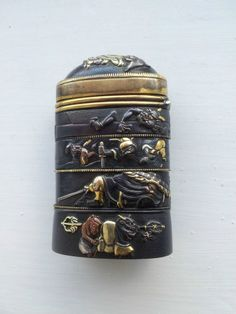 Japanese Meiji era vesta matchsafe of fuchi and koshirae shakudo mixed metals.
