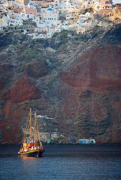 Twin masted boat in the caldera of Santorini, Greece