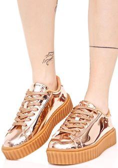Rose Trophies Metallic Creeper Sneakers cuz ya always end up in the winner's circle, babe. These dope sneakers feature a hyper metallic rose gold construction, comfy padded interior, textured gum sole creeper platform, and glitzy full length lace-ups.
