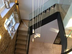 Steel staircase with timber treads and frameless glass balustrade plus curved balcony