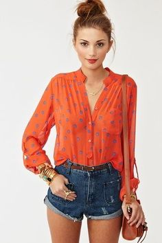 LOVE the flowy blouse tucked into high waisted jean shorts, topped with a messy top bun | elfsacks